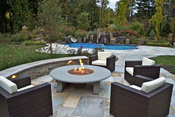 NJ Design company outdoor fire pit feature living room area 600x400 NJ Landscape Design Company