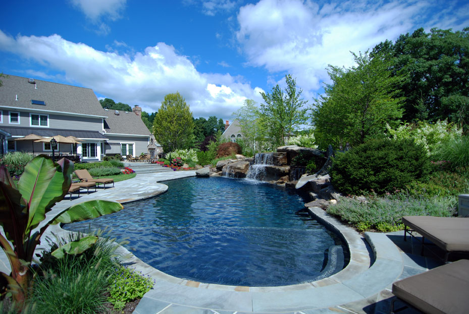 completed pool spa waterfall patio cabana fireplace grill and planting - Swimming Pool Designers