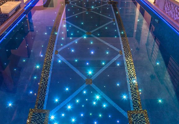 alpine nj award winning glass tile indoor pool 1 576x400 Award Winning Pools & Landscaping