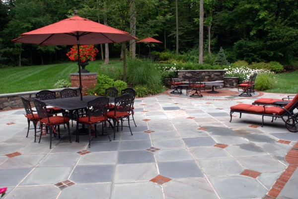 beautiful bluestone patio with brick coins and border 600x400 Masonry  Stone Patios & Walls