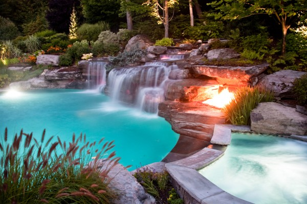 inground luxury swimming pool firepit and waterfalls nj 600x400 Luxury Swimming Pools