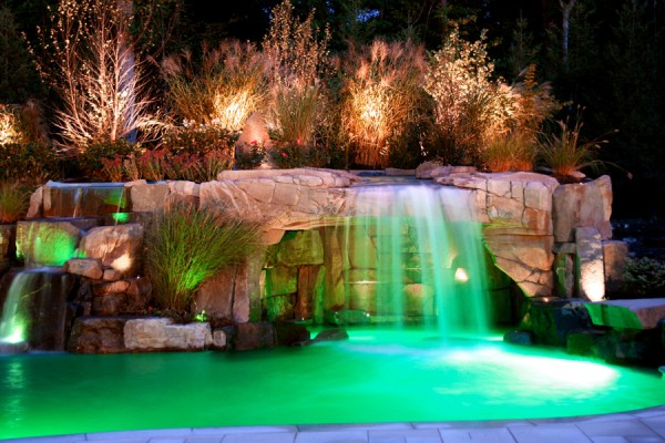 inground waterfall grotto pool design 600x400 Pool Design