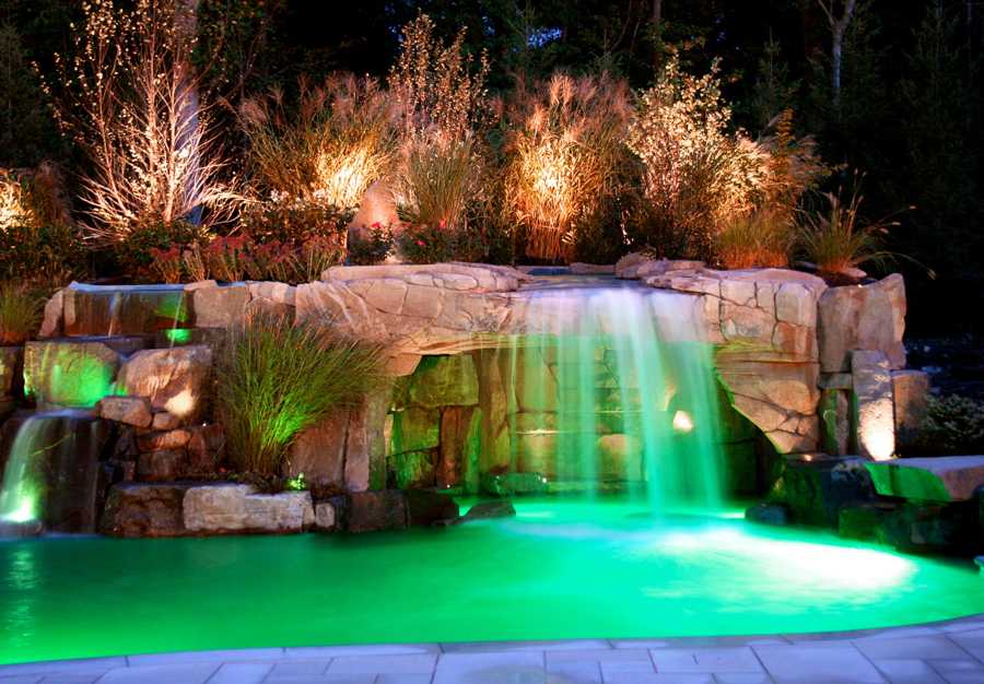 inground waterfall grotto pool design 600x417 inground waterfall grotto pool design - Swimming Pools With Grottos