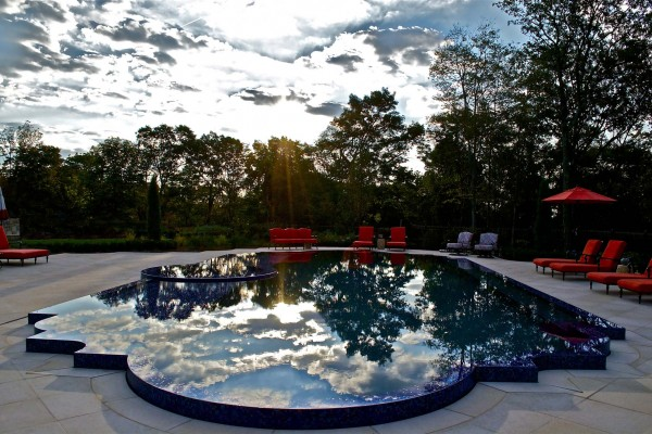 kinnelon nj award winning perimeter overflow swimming pool design 600x400 Award Winning Pools & Landscaping