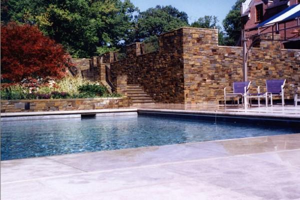 large stone veneer retaining wall design 600x400 Pool & Landscaping Testimonials