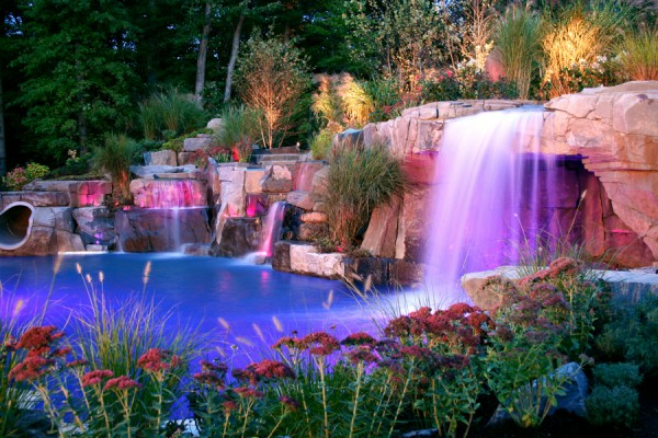 luxury custom inground pool grotto and waterfalls design 600x400 Luxury Swimming Pools