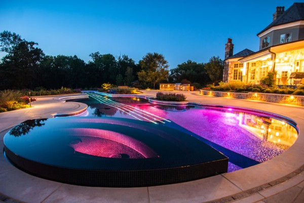 luxury perimter overflow inground swimming pool night 600x400 Luxury Swimming Pools
