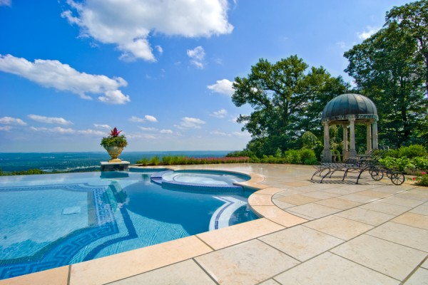 luxury vanishing edge pool with glass tile inlay ideas nj 600x400 Luxury Swimming Pools