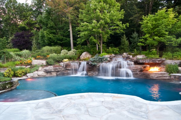 mahwah nj pool renovation volcanic fire pit luxury swimming pool waterfall 600x400 Custom Swimming Pool Renovations