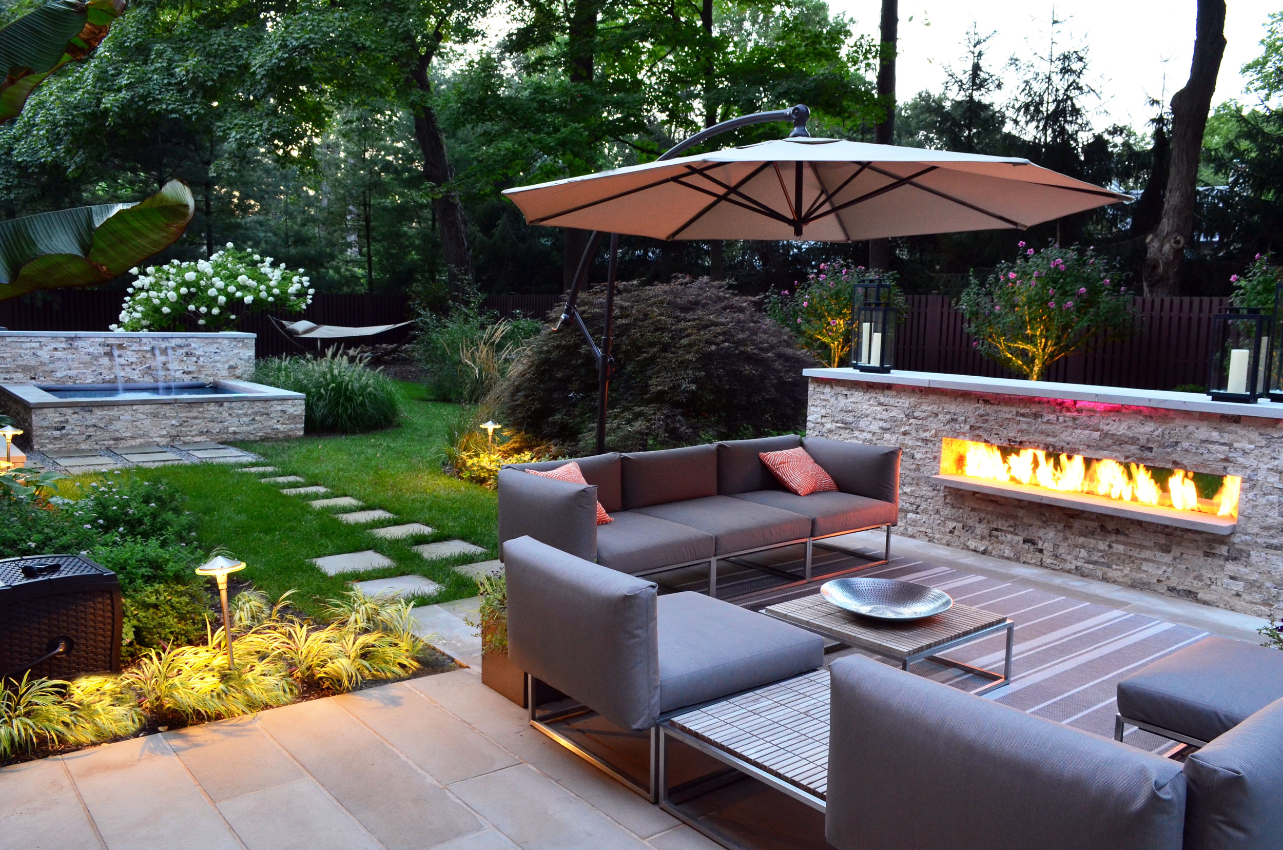 modern outdoor fire feature stone wall