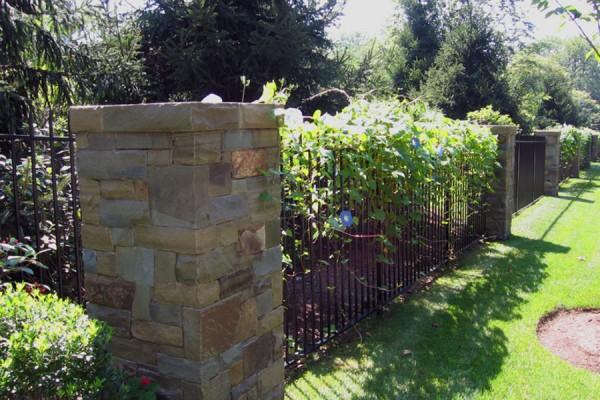 natural stone masonry pier iron fence 600x400 Masonry  Stone Patios & Walls