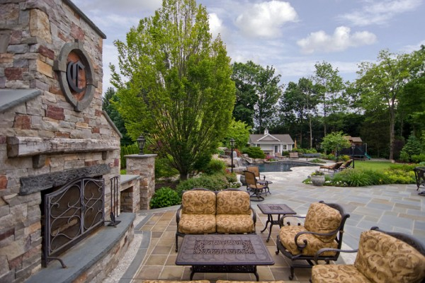 outdoor living room fireplace seating area 600x400 Pool & Landscaping Testimonials