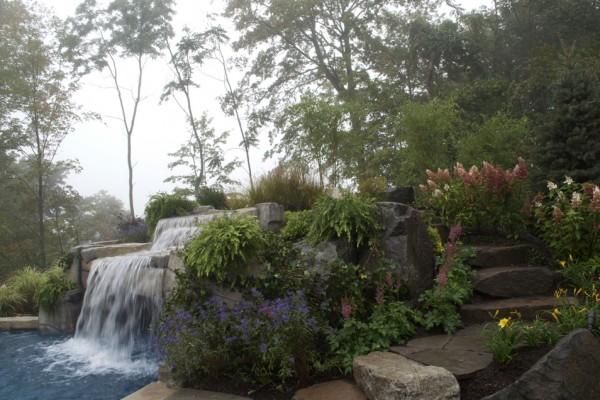 pool waterfall landscaping gardening 600x400 Landscaping & Gardens
