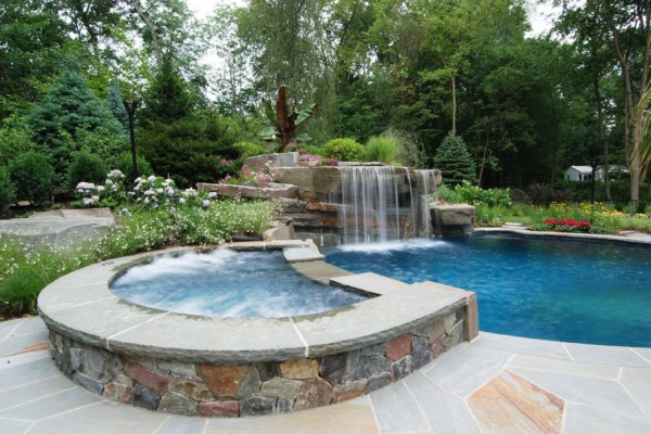 tropical waterfall pool and spa design 600x400 Pool & Landscaping Testimonials