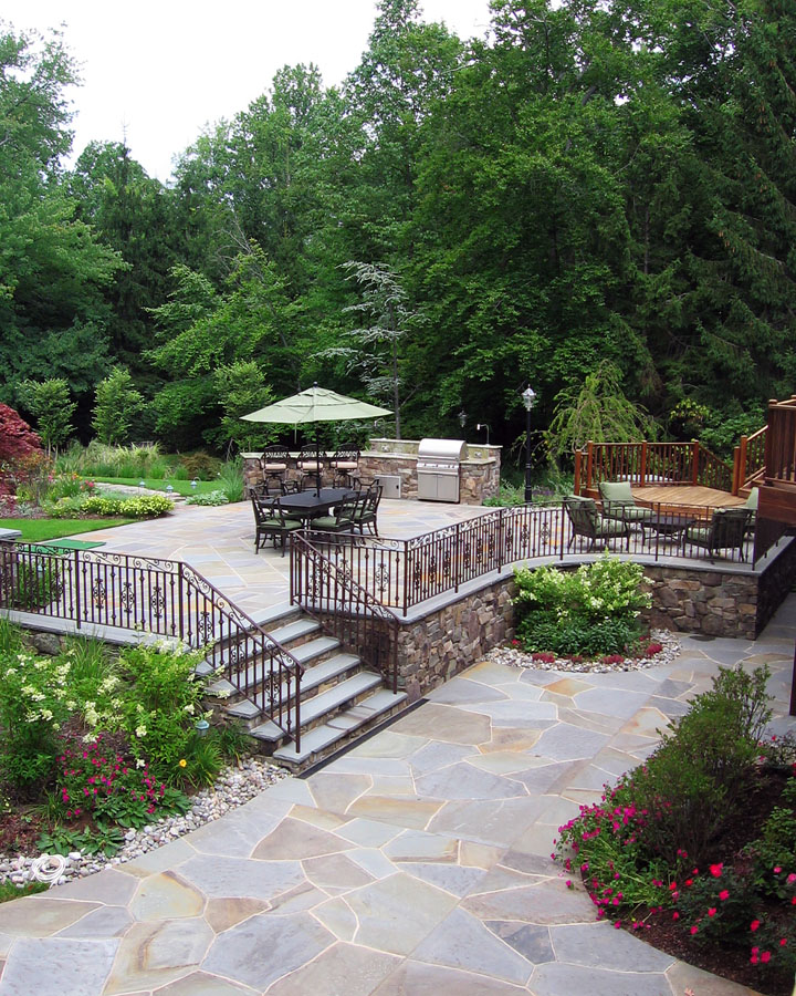 Natural stone patio wall design for pools landscaping nj for Landscape design nj