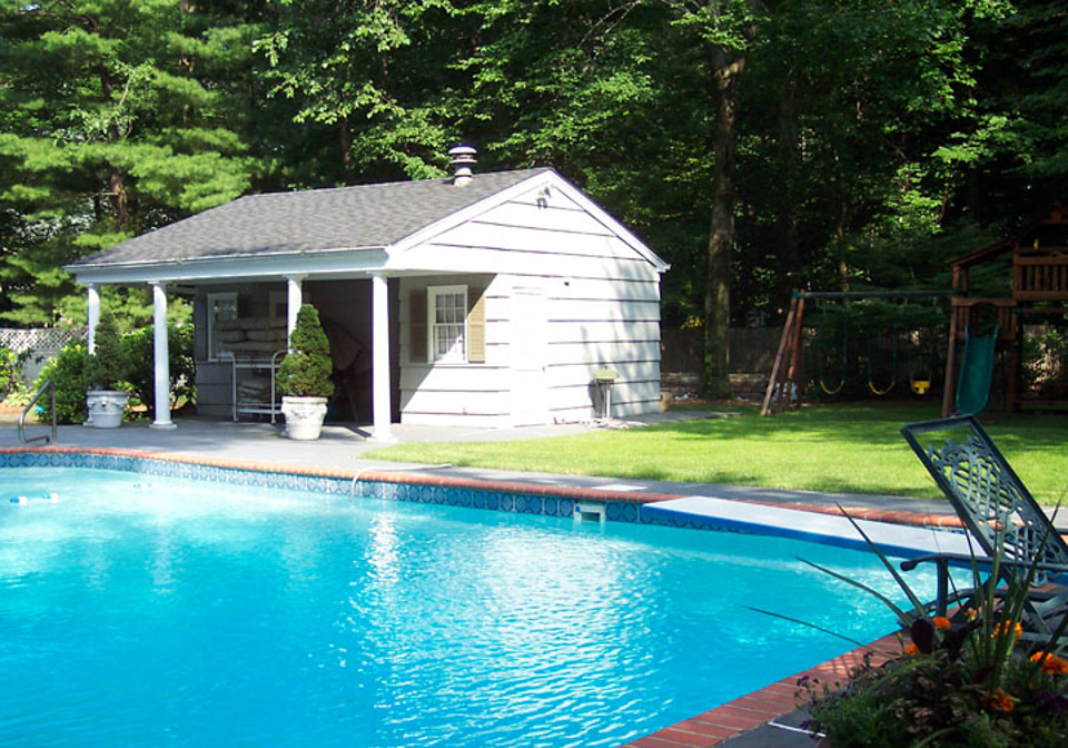 Tropical backyard waterfalls allendale nj cipriano for Custom pool cabanas