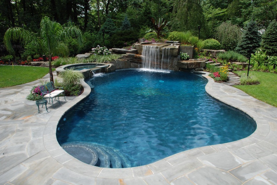 Tropical backyard waterfalls allendale nj cipriano for Custom swimming pools