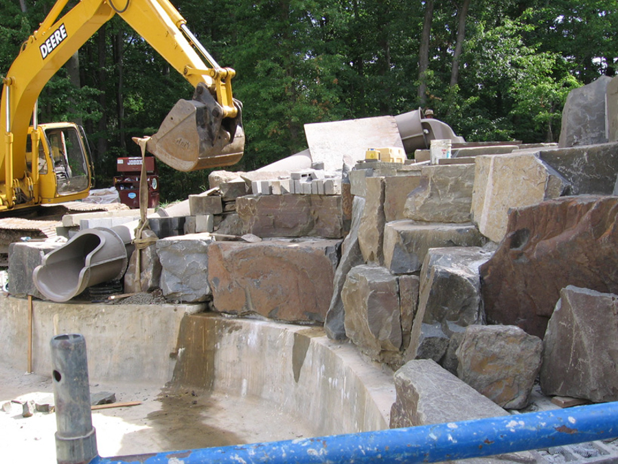 Inground pool construction expert nj builders for Building a swimming pool waterfall