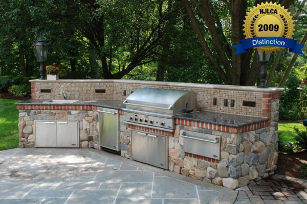 stone outdoor kitchen stone 600x400 Award Winning Pools & Landscaping