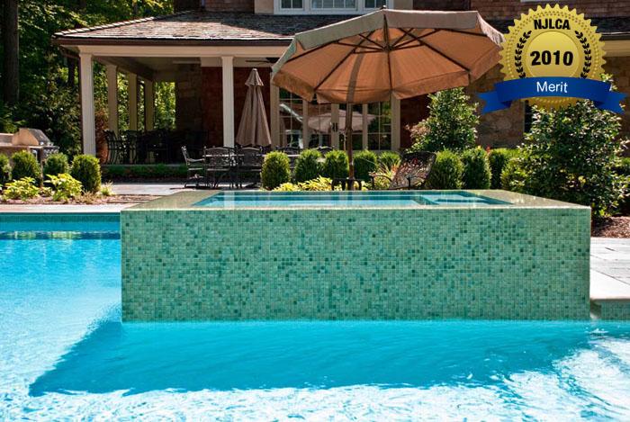 Award winning pool landscaping 2013 best design winner for Swimming pool management companies