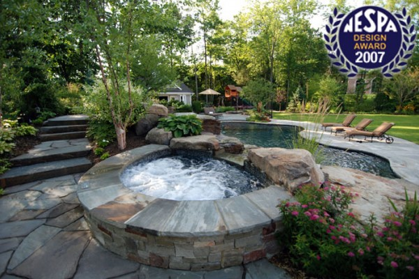 swimming pool sun shelf swimming pools 600x400 Award Winning Pools & Landscaping
