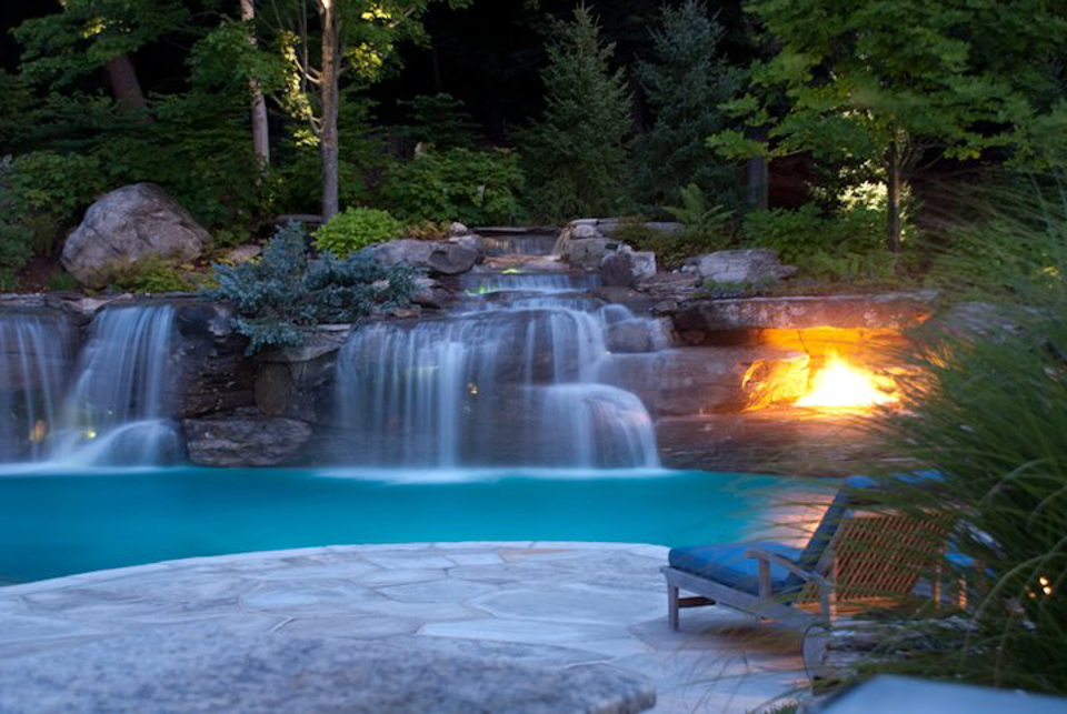 natural waterfall swimming pool fire pit design 600x402 natural waterfall swimming pool fire pit design