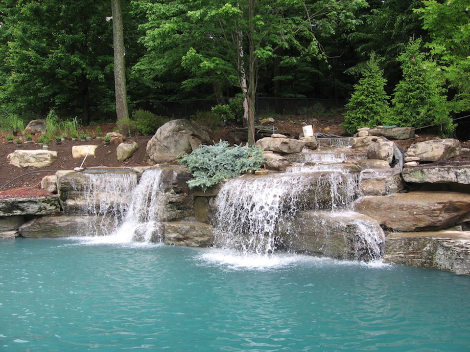 Pool waterfalls design mahwah nj cipriano landscape for Natural rock swimming pools